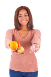 African woman and her choice - pills or fruit stock photos