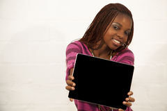 African Woman Holding a Blank black Sign. Against white background Royalty Free Stock Photography