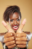 African woman holding both thumbs Royalty Free Stock Photos