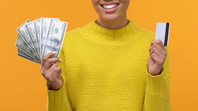African woman holding dollar banknotes and credit card in hands, bank account. Stock footage stock footage