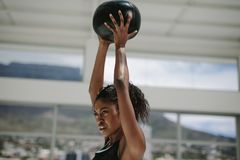 African woman training with fitness ball stock photo