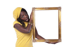 African woman holding a picture frame Royalty Free Stock Image