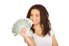 African woman holding polish money. Stock Photo