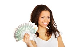 African woman holding polish money. Stock Photos