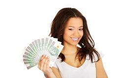 African woman holding polish money. Stock Photos
