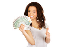 African woman holding polish money. Stock Images