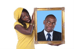 African woman holding a portrait of a businessman Royalty Free Stock Photos