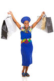 African woman holding shopping bags Royalty Free Stock Images