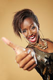 African woman holding thumbs up Royalty Free Stock Photo