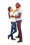 African woman hugging boyfriend Stock Photos