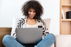 Free African Woman Indoors At Home Using Laptop Computer Stock Photos - 179142993