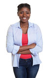 African woman with jeans and crossed arms Royalty Free Stock Images