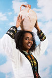African woman with jug Stock Images