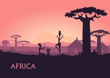 African woman on Kenya sunset background. The landscape of Africa, baobabs and traditional huts. African landscape with local woman, baobabs and traditional huts Stock Image