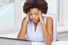 African woman with laptop at office Stock Photo