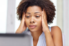 African woman with laptop at office Royalty Free Stock Image