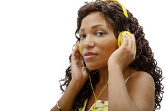 African woman listening to music. With yellow headphones Stock Image