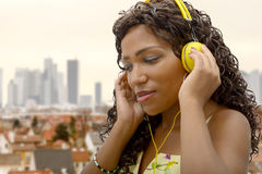 African woman listening to music Stock Photography