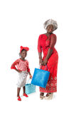 African woman and little girl in traditional clothing with tote bags.Isolated Royalty Free Stock Images