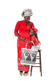 African woman and little girl in traditional clothing with tote Royalty Free Stock Photography