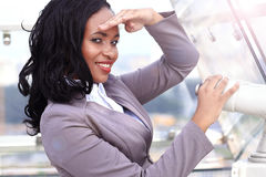 African woman looking through binoculars Stock Photography