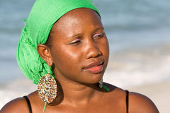 African woman looking interested. Portrait of young african woman with headscarf is looking interested Stock Photography