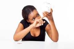 African woman looking piggybank Stock Images