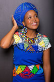 African woman looking up. Pretty young african woman looking up on black background Stock Photos