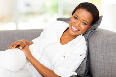 African woman lying couch Royalty Free Stock Image