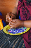 African woman making souvenirs for sell at Lesedi Cultural Villa Stock Photo