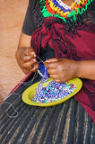African woman making souvenirs for sell at Lesedi Cultural Villa Stock Image