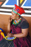 African woman making souvenirs for sell at Lesedi Cultural Villa Stock Photography