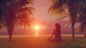 African woman meditating on tropical beach at sunrise stock footage