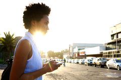 African woman with mobile phone on the city street Stock Photos