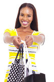African woman offering shopping stock photography