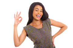 African woman okay. Cheerful young african woman giving okay sign Royalty Free Stock Images