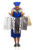 African woman opening shopping Royalty Free Stock Photography