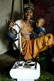 An african woman performing a coffee ceremony. An african woman with a child is performing a coffee ceremony, gondar, ethiopia. photo was taken on september 13 Royalty Free Stock Images