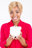 African woman with piggy bank Royalty Free Stock Image