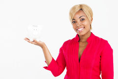 African woman with piggy bank Royalty Free Stock Photo