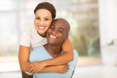 African woman piggyback boyfriend Stock Photo