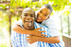 African woman piggyback boyfriend Stock Images