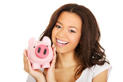 African woman with piggybank. Royalty Free Stock Image
