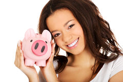 African woman with piggybank. Royalty Free Stock Images