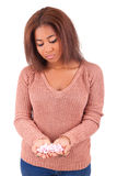 African woman with pills medicine tablets. Isolated Royalty Free Stock Images