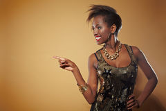 African woman pointing with finger Royalty Free Stock Images