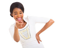 African woman pointing laughing. Cute african american woman pointing and laughing isolated on white Stock Photo