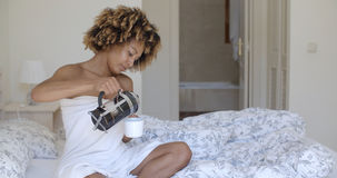 African woman pouring freshly brewed coffee Stock Photography