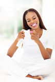 African woman pregnancy test. Happy african woman looking at pregnancy test at home royalty free stock image