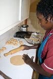 African Woman prepares Chapati Stock Photos